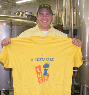 Lucid owner, Jon Messier poses with one of their Kickstarter rewards.
